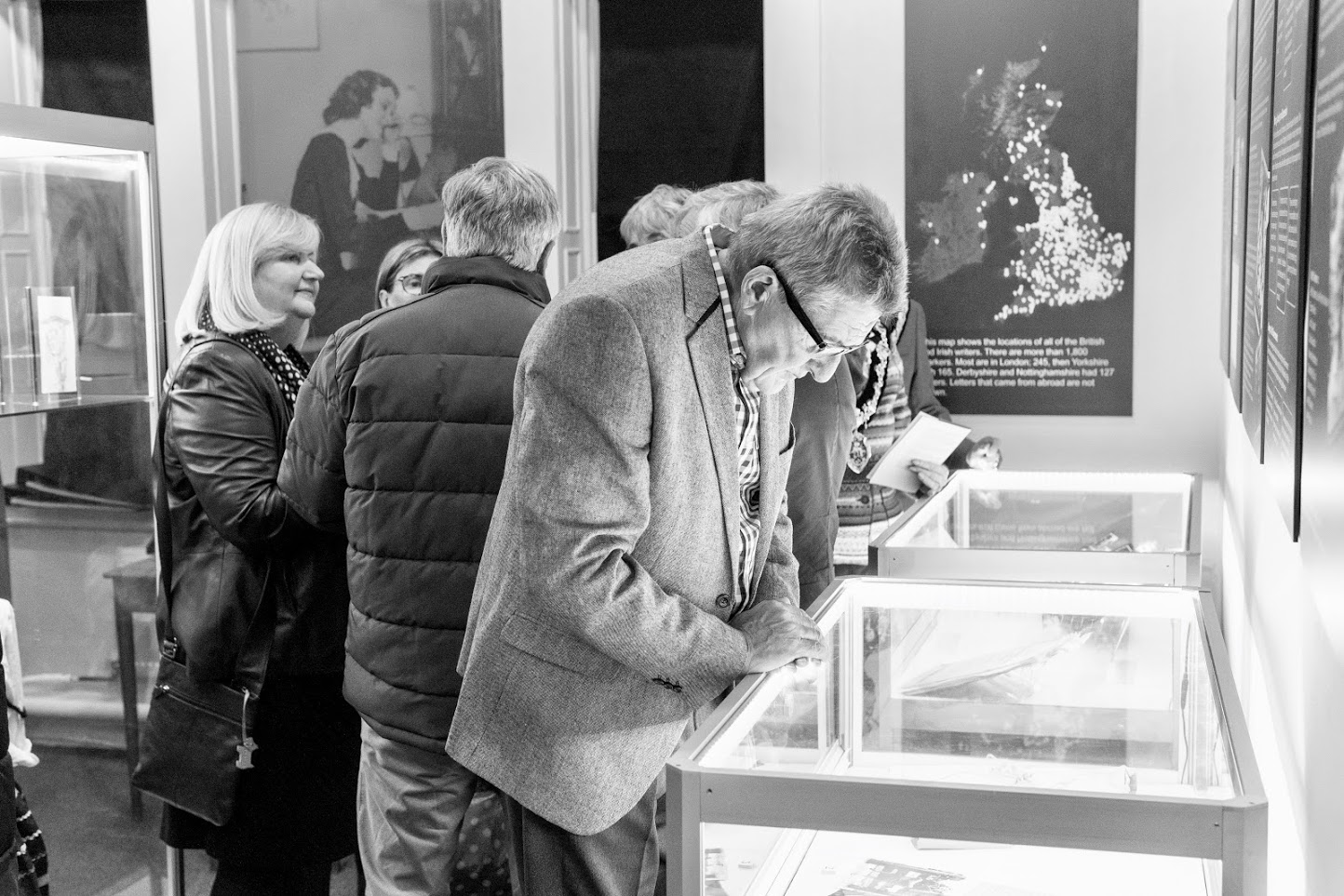 black and white image of visitors looking at Hope Robinson Gallery
