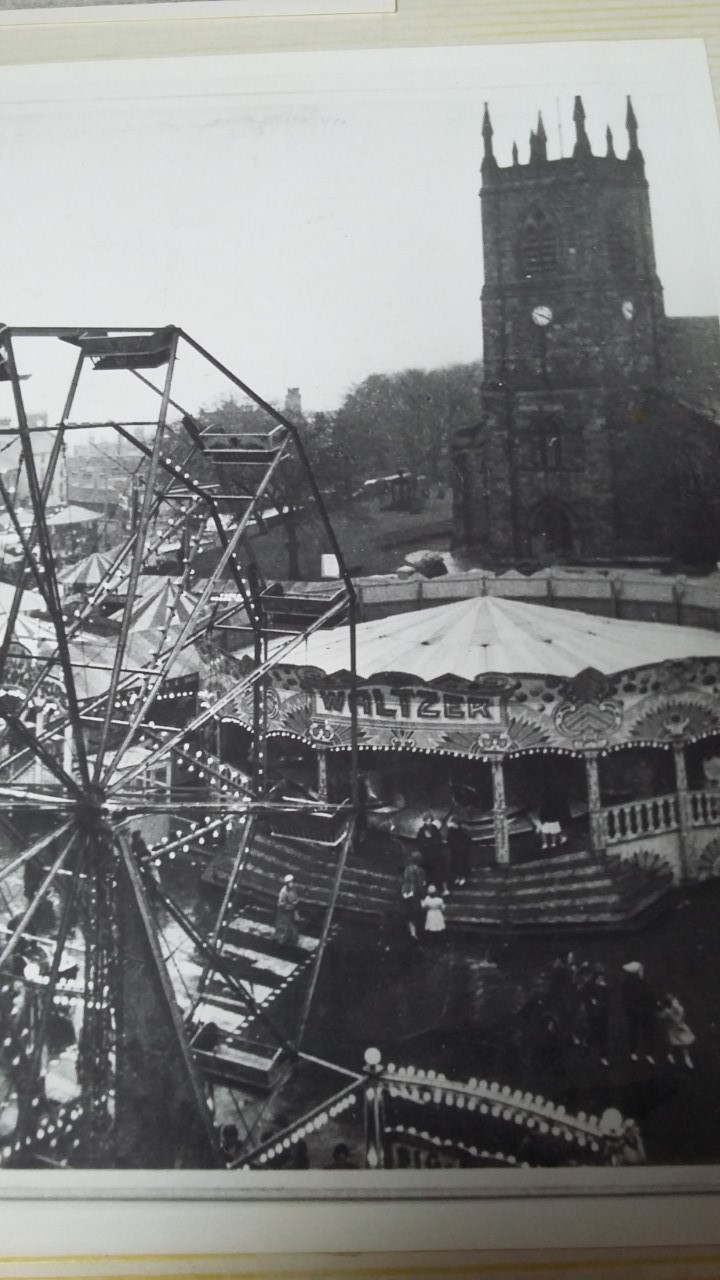 black and white image of fair and church on market place